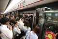 A tight squeeze for commuters at Mong Kok station at about 9am on Tuesday. Photo: Felix Wong/SCMP