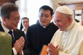 Pope Francis and South Korean President Moon Jae-in gesture as they exchange gifts at the Vatican on Thursday. Photo: Agence France-Presse