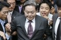 Samsung Group chairman Lee Kun-hee leaves the trial that saw him convicted of tax evasion in 2008. Photo: Reuters