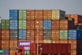 A truck transports a container next to stacked containers at a port in Qingdao in China's eastern Shandong province on October 12, 2018. Photo: STR/AFP