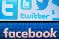 A combination of Twitter and Facebook logos. Photo: AFP