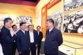 Chinese President Xi Jinping (right) visits an exhibition in Shenzhen on Guangdong's leading role in reform and opening up 40 years ago. Source: People's Daily