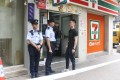 Police officers guard the entrance to the store on Po On Road, Cheung Sha Wan. Photo: Handout