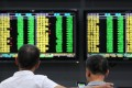 Investors monitor stock prices at a securities company in Jiujiang in China's central Jiangxi province. The benchmark Shanghai Composite Index rose by 0.3 per cent on Wednesday, paring a gain of as much as 1.8 per cent. Photo: AFP