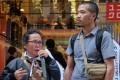 Indonesian workers Warni Lena Napitupulu and Tedy Senadi Putra in Tokyo to demand a meeting with Uniqlo. Photo: Handout.