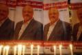Candles shine on placards protesting the killing of Saudi journalist Jamal Khashoggi during a vigil outside Saudi Arabia's consulate in Istanbul on Thursday. Photo: AP