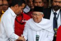 Indonesian President Joko Widodo with his vice-presidential running mate for the 2019 presidential election Islamic cleric Ma'ruf Amin in Jakarta. Photo: Reuters