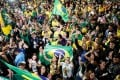 Supporters of Jair Bolsonaro, far-right lawmaker and presidential candidate of the Social Liberal Party (PSL), celebrate after Bolsonaro wins the presidential race, in Sao Paulo, Brazil. Photo: Reuters