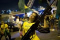 A supporter of presidential candidate Jair Bolsonaro, holds an oversized, fake rifle, as she celebrates the election results in Rio de Janeiro. Photo: AP