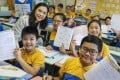 Principal Jojo Chan, with some of her pupils, says most parents approve of the arrangement. Photo: K.Y. Cheng