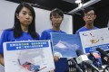 Members of the Hong Kong Dolphin Conservation Society call upon the government to conserve marine life before developing a new artificial island off Lantau, in Mong Kok on October 22. Photo: Nora Tam