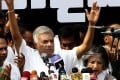 Former Sri Lankan Prime Minister and United National Party leader Ranil Wickremesinghe prepares to address supporters during a rally near the prime ministerial residence in Colombo on Tuesday. Photo: EPA