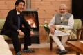 Japanese leader Shinzo Abe and his Indian counterpart Narendra Modi sit by the fire at Abe's holiday home. The fact that the two leaders met at Abe's residence has been highlighted as symbolic of their close relationship. Photo: Twitter