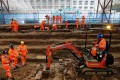Field archaeologists carry out excavation works at the cemetery under St James Gardens near Euston railway station in London. Photo: AFP