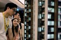 Prospective buyers looking at a model of the LP6 property development by Nan Fung Group at a sales centre in Hong Kong on August 26. Photo: Reuters