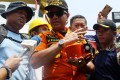 Chief of Indonesia's National Search and Rescue Agency Muhammad Syaugi displays the core of the Lion Air JT610 flight data recorder, or black box, to journalists shortly after it was found on Thursday. The box's external casing and electronics were shattered when the plane crashed. Photo: EPA