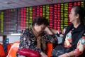 Day traders taking a break at a stockbrokerage in Shanghai on October 15, 2018. Contrary to global conventions, China's stock exchanges denote declines in green, using the red colour to represent gains and advances.Photo: AFP