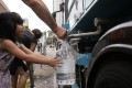 Residents fill up containers of drinking water from a temporary standpipe, after a partial power failure at Hiu Kwong Street in Sau Mau Ping in June 2016. Photo: Sam Tsang