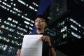 Activist Joshua Wong Chi-fung, secretary-general of pro-democracy party Demosisto, with the party's report.Photo: Sam Tsang