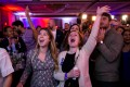 Alyssa Giammarella and Claire Viall cheer as they watch election results come in at a Democratic election night rally in Washington. Photo: Reuters