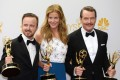 Aaron Paul (left), Anna Gunn and Bryan Cranston pose with the Emmys Breaking Bad won in 2014 for outstanding drama series, lead actor, supporting actor and supporting actress. Breaking Bad is coming back in movie format, Cranston says. Photo: AFP