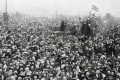 A crowd gathers outside Buckingham Palace to celebrate the end of the war, on November 11, 1918. Picture: Alamy