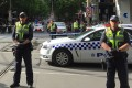 Policemen block members of the public from walking towards the Bourke Street mall in central Melbourne. Photo: Reuters