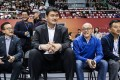 Yao Ming (second left) and Joe Tsai (left) sit courtside for the Pac-12 China Game. Photos: Alisports