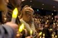 People gather to pray for the victims of a mass shooting during a candlelight vigil in Thousand Oaks, California. Photo: AP