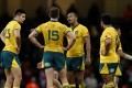 Australia's Kurtley Beale and teammates look dejected after the loss to Wales in Cardiff. Photo: Reuters