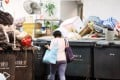 Waste is piled up at a refuse collection point in March 2017. The Hong Kong government has proposed that housing estates, residential buildings and shops using government refuse collection services pay for each bag of waste disposed. Photo: David Wong