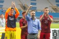Gary White (centre) raises his fist after the final whistle. Photo: HKFA