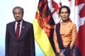 Malaysia's Prime Minister Mahathir Mohamad and Myanmar State Counsellor Aung San Suu Kyi pose for a group photo with other leaders at the opening ceremony of the 33rd Asean summit. Photo: AFP
