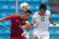 Hong Kong's Yang Huang heads the ball against North Korea in Taipei. Photos: HKFA