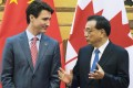 Chinese Premier Li Keqiang (right) and Canadian Prime Minister Justin Trudeau discussed the expansion of trade ties between the two nations. Photo: Kyodo