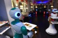 Robot waiters deliver food to customers at Naulo restaurant in Kathmandu. Photo: AFP