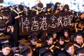 Students hold up a banner which says: 'Remember Hong Kong's political prisoners'. Photo: Felix Wong