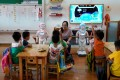 Humanoid robots are used to help teach children at a kindergarten in Suzhou, Jiangsu province. Photo: Reuters