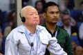 Khmer Rouge leader Khieu Samphan listens to his verdict at the Extraordinary Chambers in the Courts of Cambodia in Phnom Penh on Friday. Photo: AFP