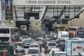 Vehicles pack either side of the Cross Harbour Tunnel. Photo: Xiaomei Chen