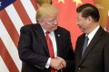 In this file photo taken on November 9, 2017, US President Donald Trump shakes hands with China's President Xi Jinping in Beijing. Photo: Agence France-Presse