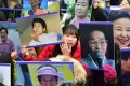 Portraits of former 'comfort women' are held aloft at an anti-Japanese rally in Seoul. Photo: AFP