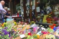Floral tributes can be seen outside on November 12 outside Melbourne's Pellegrini's Cafe for Sisto Malaspina, after he was stabbed to death on November 9 in an attack police have called an act of terrorism, in central Melbourne, Australia. Photo: Reuters