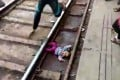 The baby was wedged flat on her back between the track and the platform. Photo: AFP
