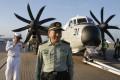 Lt Gen Tan Benhong flew to the USS Ronald Reagan on Tuesday. Photo: AP