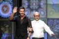 Italian designers Domenico Dolce (right) and Stefano Gabbana acknowledge the applause at the end of their Spring/Summer 2012 women's collection show, during Milan Fashion Week in September 2011. Photo: Reuters