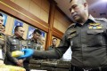 Thai police inspect seized drugs during a press conference in Bangkok. Photo: AFP