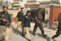 Policewoman Suhai Aziz Talpur helping secure the Chinese consulate attack in Karachi. Photo: Handout