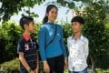 Thuch Salik (right), his mother, and younger brother Tithya, who speaks 12 languages – nearly as many as his brother – in Phnom Penh, the Cambodian capital. Photo: Enric Català