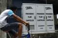 A man rides past a routing box for phone lines, installed by ZTE for Venezuela's national telecommunications company CANTV in Barinas, Venezuela, in this September file photo. Photo: Reuters